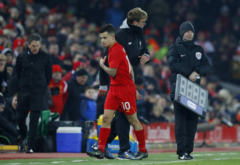 Liverpool's Philippe Coutinho walks past manager Juergen Klopp as he is substituted