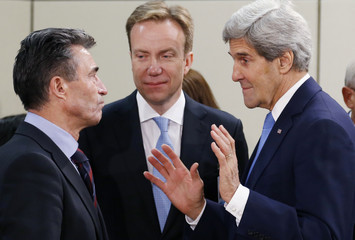 NATO Secretary General Rasmussen and Norway's Foreign Minister Brende listen to U.S. Secretary of State Kerry during NATO-Russia foreign ministers meeting in Brussels