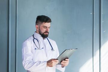 Doctor working near window in a hospital.