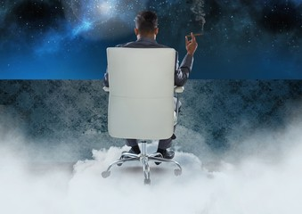 Businessman Back Sitting in Chair with cigar and cloudy sky