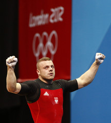 Poland's Adrian Edward Zielinski reacts after successful lift on the men's 85Kg group A weightlifting competition at the ExCel venue at the London 2012 Olympic Games
