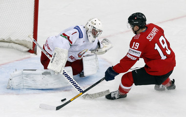 Switzerland's Schappi scores against goaltender Koval of Belarus during the first period of their men's ice hockey World Championship group B game at Minsk Arena in Minsk