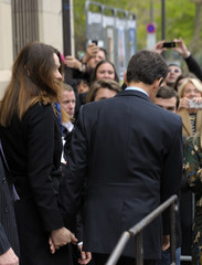 France's President and UMP party candidate for the 2012 French presidential elections Sarkozy leaves a polling station after he cast his ballot in the first round of the 2012 French presidential election in Paris