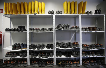 Rubber and safety boots are pictured at the construction site of Berlin City Palace during in Berlin