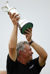 Darren Clarke of Northern Ireland holds the Claret Jug after winning the British Open golf championship at Royal St George's in Sandwich