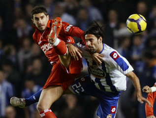Deportivo Coruna's Rodriguez battles for the ball with Sevilla's Dragutinovic during their Spanish King's Cup quarterfinal soccer match in Coruna