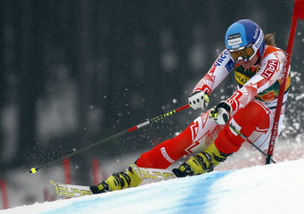 Poutiainen of Finland cuts a curve during the women's Alpine skiing World Cup giant slalom event in Spindleruv Mlyn