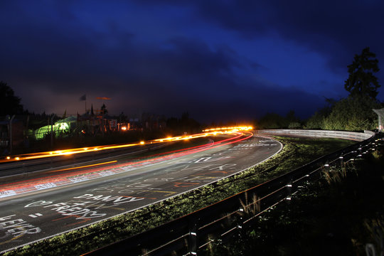 Racing car tail lights during the Nürburgring 24h race, long exposure at the Schwalbenschwanz bend