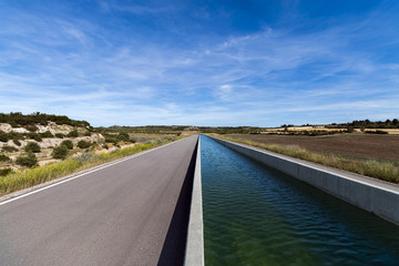 Straight Irrigation Canal in Farmland Landscape
