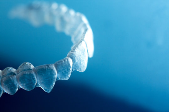 Invisible orthodontic aligners