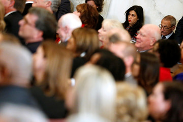 Abedin and Podesta attend a portrait unveiling ceremony for retiring Reid on Capitol Hill in Washington
