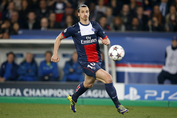 Paris St Germain's Zlatan Ibrahimovic runs with the ball during their Champions League round of 16 second leg soccer match against Bayer Leverkusen at the Parc des Princes Stadium in Paris,