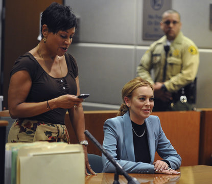 Actress Lindsay Lohan and attorney Shawn Holley attend a progress report hearing in her DUI case at Airport Branch Courthouse in Los Angeles