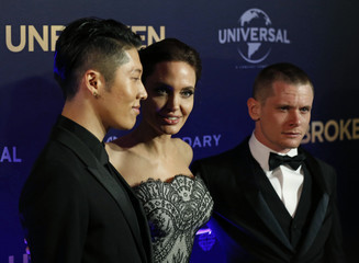 "Cast members Miyavi and Jack O'Connell pose with director Angelina Jolie at the world premiere of their film ""Unbroken"" in Sydney"