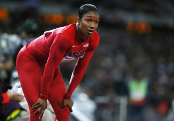 Carmelita Jeter of the U.S. reacts after she took second place in her women's 200m semi-final during the London 2012 Olympic Games at the Olympic Stadium