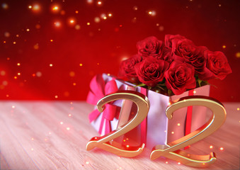 birthday concept with red roses in the gift on wooden desk. twenty-second. 22nd. 3D render
