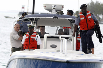 Britain's Prince Harry travels in a Royal Bahamas Defence Force boat as he arrives for a tour of Harbour Island in Nassau