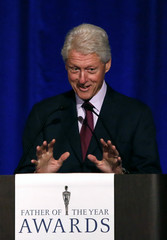 Former U.S. President Bill Clinton speaks as he is named 'Father of the Year' at a lunch in New York