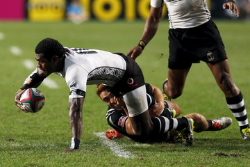 Fiji's Savenca Rawaca (L) is tackled by New Zealand's Joe Webber during the final of Hong Kong Sevens rugby tournament in Hong Kong