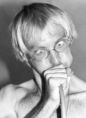 File picture of Tour de France leader Fignon of France grimaces as he blows into a device for testing his lungs during the obligatory medical examination prior the Tour de France cycling race departure in West Berlin