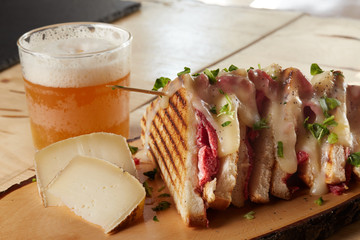 club sandwich with salami and cheese on wooden tray