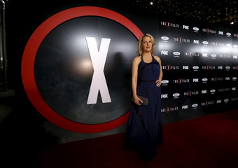 """Cast member Gillian Anderson poses at a premiere for """"The X-Files"""" at California Science Center in Los Angeles, California"""