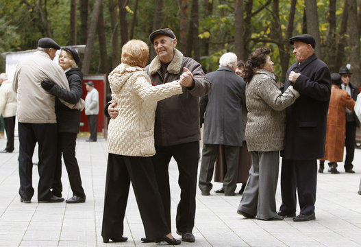 Elderly people dance in a park in central Minsk