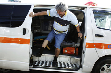 Alberto Acosta boards an ambulance after receiving a prosthetic leg at the Center of Advanced Prosthetics in San Jose