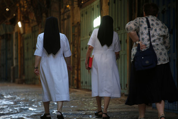 Nuns walk in an alley in the Christian Quarter of Jerusalem's Old City