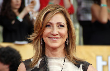 Edie Falco arrives at the 20th annual Screen Actors Guild Awards in Los Angeles