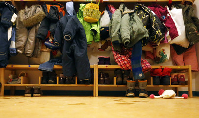 Winter boots and clothing of children are stored in shelving at a Kindergarten in Hanau