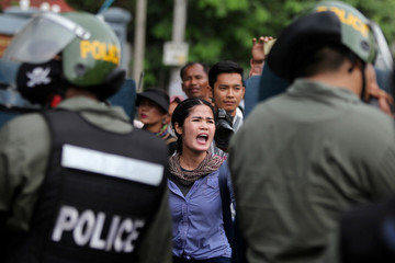 A supporter of opposition CNRP takes part in a march to deliver petition to the parliament and King Norodom Sihamoni to intervene in ther country's current political crisis in Phnom Penh