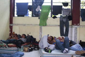"""Students from the Ayotzinapa Teacher Training College """"Raul Isidro Burgos"""" rest on mattresses in a classroom used as a dormitory in Tixtla, in the outskirts of Chilpancingo"""