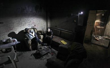 Free Syrian Army fighters sit inside a room in Deir al-Zor, eastern Syria