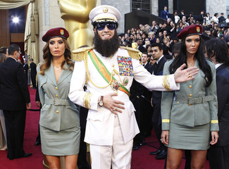 """Cohen arrives in character from his upcoming film """"The Dictator"""" at the 84th Academy Awards in Hollywood"""