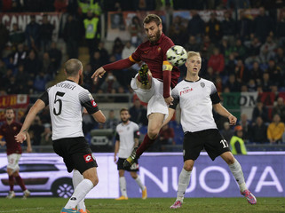 AS Roma's De Rossi shoots to score as he is challenged by Cesena's Magnusson during their Italian Serie A soccer match at the Olympic stadium in Rome