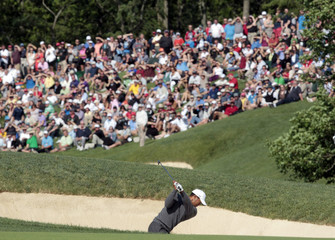 Tiger Woods of the US chips out of the sand on the 17th fairway during the third round of the Memorial Tournament at Muirfield Village Golf Club in Dublin