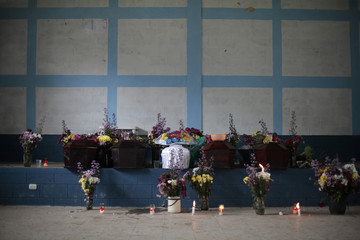 Coffins of Gonzales family members shot dead during attack by unknown assailants are seen before funeral at Las Escobas village in Villacanales