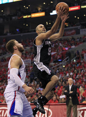 San Antonio Spurs Tony Parker goes to the basket past Los Angeles Clippers Blake Griffin during Game 4 of their NBA Western Conference semi-final playoff game in Los Angeles