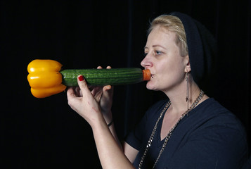 Austrian musician Martina Winkler, a member of the Vegetable Orchestra, poses for a picture with a musical instrument made from vegetables in Haguenau, eastern France