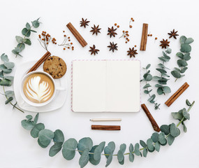 Workspace with notebook, coffee, keyboard and leaves.  Flat lay composition for bloggers, magazines, social media and artists. Top view.