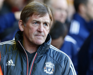 Liverpool's manager Kenny Dalglish watches before their English FA Cup quarter-final soccer match against Stoke City at Anfield in Liverpool