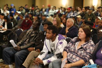 XL Foods workers listen to O'Halloran, president of the United Food and Commercial Workers Local 401, during a news conference in Brooks