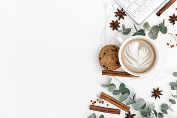 Feminine background with coffee, and keyboard on white background. flat lay, top view, copy space. Morning concept