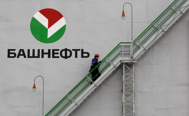 Employee walks up stairs at Bashneft - Novoil refinery in Ufa