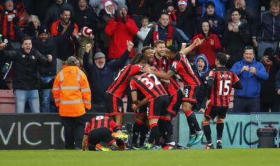 Bournemouth's Steve Cook celebrates scoring their third goal with teammates