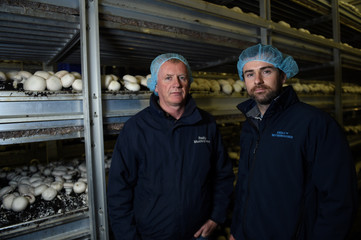 Gerry Reilly and son, Kevin Reilly, owners of Reilly Mushrooms pose for a picture on their mushroom farm in Athlone