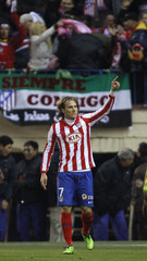 Atletico Madrid's Forlan celebrates his goal during their Spanish first division match against Barcelona in Madrid