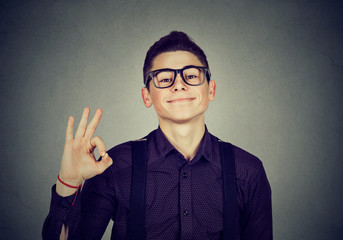 Nerdy man showing ok sign