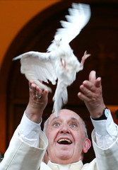 Pope Francis releases a dove at the end of a visit to the Chaldean Catholic Church of St. Simon Bar Sabbae in Tbilisi